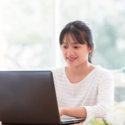asian-businesswoman-working-use-laptop-for-documents-paper-report-in-office_4236-550
